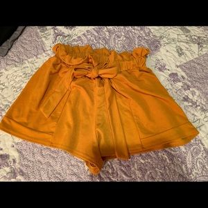 Mustard Yellow Bucket Short from PrettyLittleThing